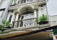Bán nhà mặt tiền Thăng Long, P. 4, Q. Tân Bình, kết cấu trệt 3 lầu ST, DT: 5.1x25m, nở hậu 5.2m