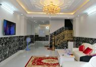 Xuất cảnh bán rẻ nhà xinh 4.8 x 14m trệt 5 lầu thang máy Thành phố Sài Gòn
