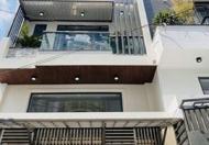 Cần bán gấp nhà 4 tầng mới ở ngay đường Đồng Nai, Quận 10, giá chỉ 5.6 tỷ.